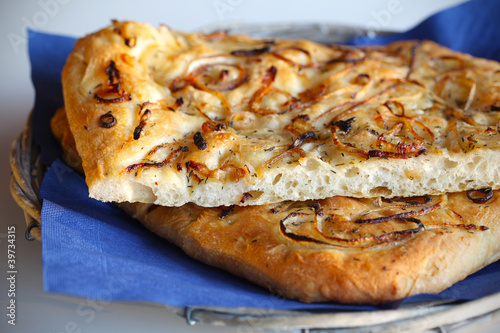 Focaccia bread with onions and thyme in a twiggy basket