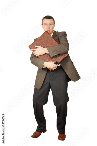 Man has clasped a suitcase by hands