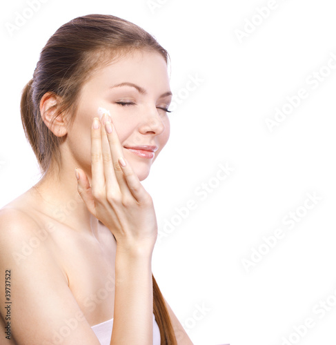 applying facial cream