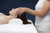 practitioner massaging a patient