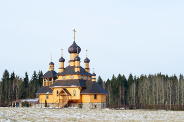 Wooden church against winter wood