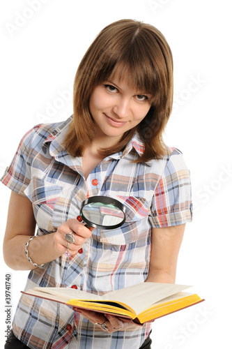 Eye and magnifying glass and book
