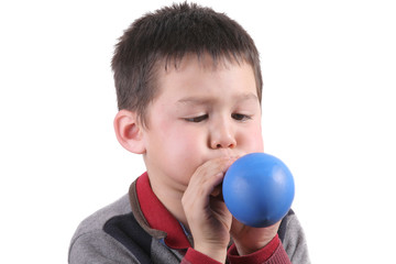 Child is blowing balloon