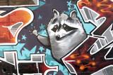 Graffiti de un mapache, arte urbano