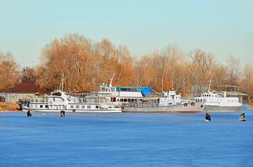 Ship at small river harbor at winter