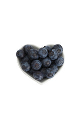 Delicious blueberries formed into a heart shape