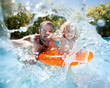 Child with father in swimming pool