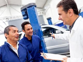 Group of car mechanics