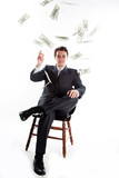 young businessman in a dark suit surrounded by flying dollars