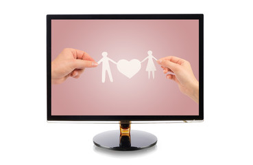 monitor with a paper family in hands isolated on white