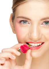 Girl with rose bud in her mouth