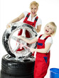 Blonde sisters cleaning summer tyres and polishing an alu rim