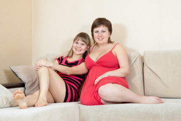 Relaxed women resting on sofa