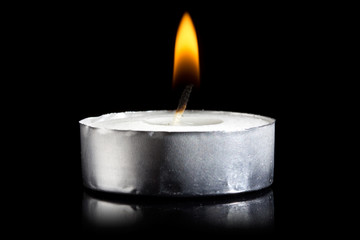 burning candle in darkness
