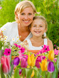 Gardening - mother with daughter in spring garden