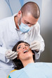 Female patient having her teeth examined by specialist