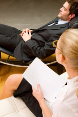 psychiatrist examining a male patient