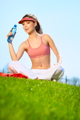 Beautiful Fitness Woman Drinking Water