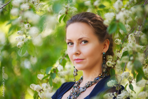 Beautiful woman in a spring garden