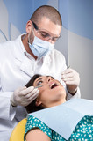 Female patient having her teeth examined by specialist poster