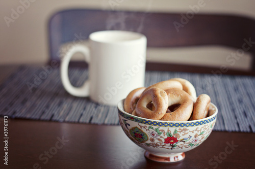 ring-shaped rolls and a cup of tea