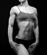 Black and white image of a muscular female body