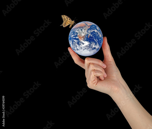 Planet Earth in hand.Elements of this image furnished by NASA