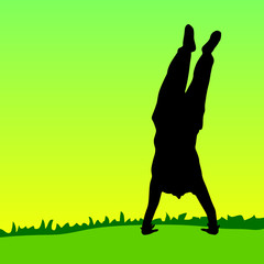 handstand on green grass black silhouette