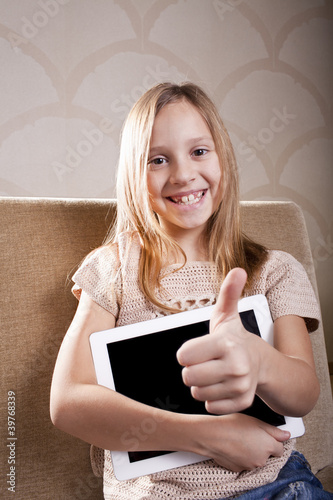 smiling girl with tablet computer