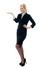 Full pose of charming young businesswoman