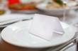 Blank plate and card for guests in restaurant