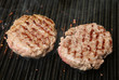 Beef Burgers Cooking on Griddle Plate