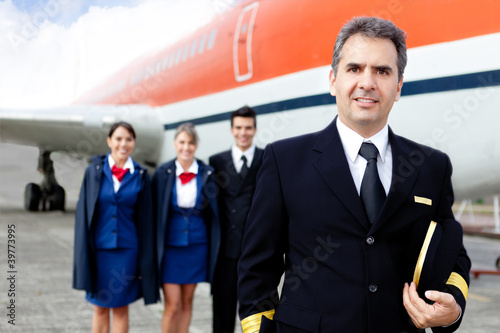 Airplane captain with crew