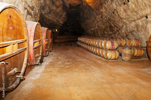 wine barrels in a winery, France
