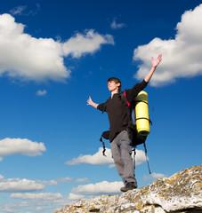 Man on top of mountain.