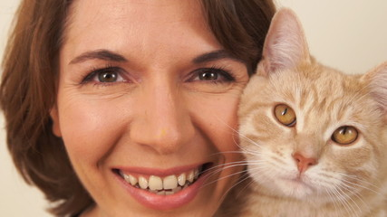 Happy woman with pet cat.
