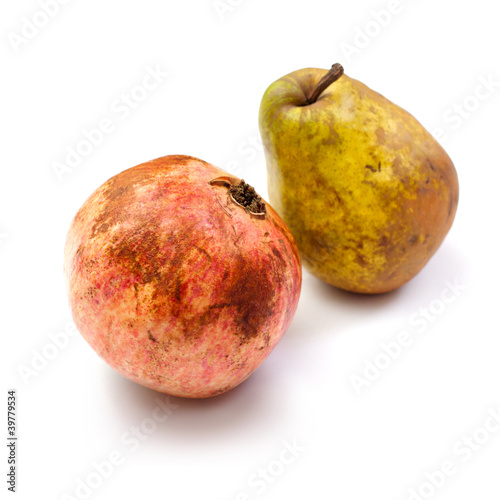 pomegranates and pear on a white