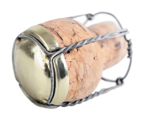 champagne cork over white background