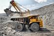 Leinwanddruck Bild - Loading of iron ore on truck