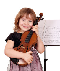 little girl with violin posing