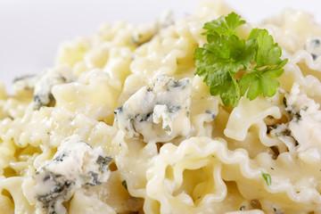European cuisine. Pasta in cream sauce with blue cheese