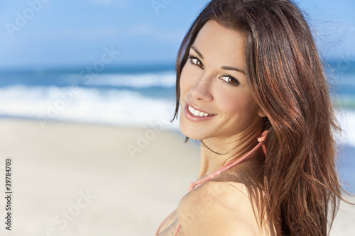 Sexy Brunette Girl on a Beach