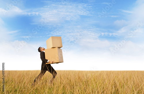 Businessman delivering boxes