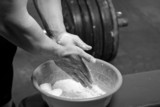 Closeup of hands of the weightlifter in talc