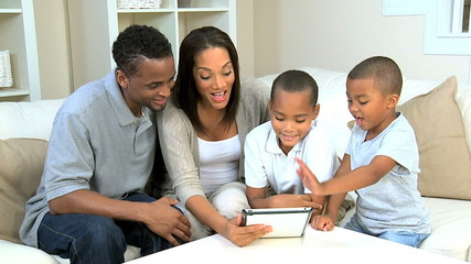 Young Family Using Wireless Tablet for Online Video Chat