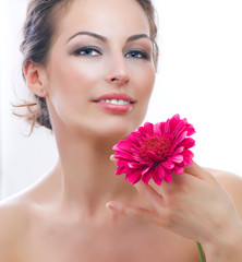 Beautiful Young Woman Portrait with Red Gerbera Flower. Spa.