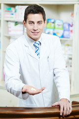 Handsome Pharmacy chemist man in drugstore