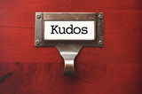 Lustrous Wooden Cabinet with Kudos File Label poster