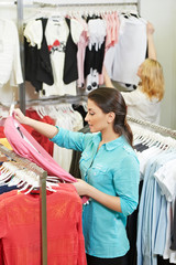 Young woman at apparel shopping