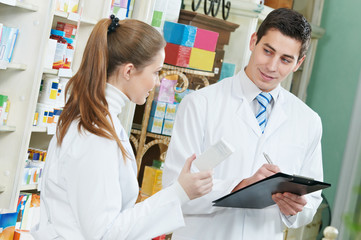 Two Pharmacy chemist workers in drugstore